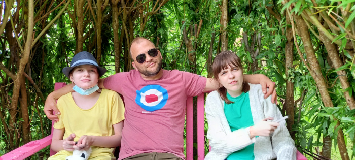 Personalities, Boo, Graham and Star sitting on a bench with trees in the background.