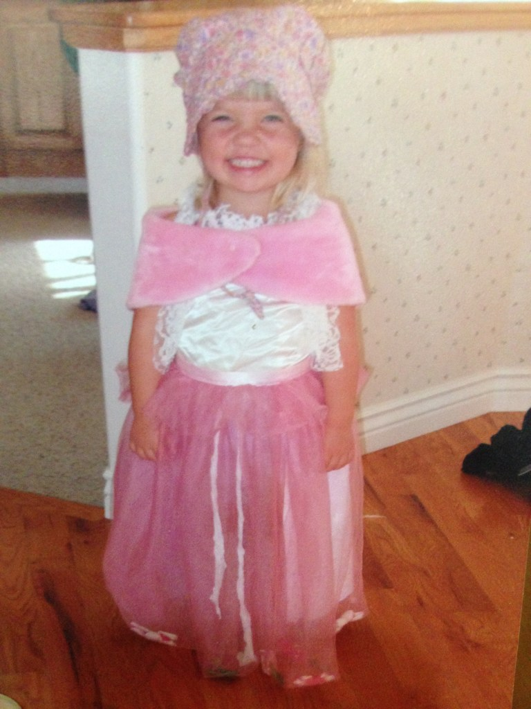 Smiling little Rebecca in costume