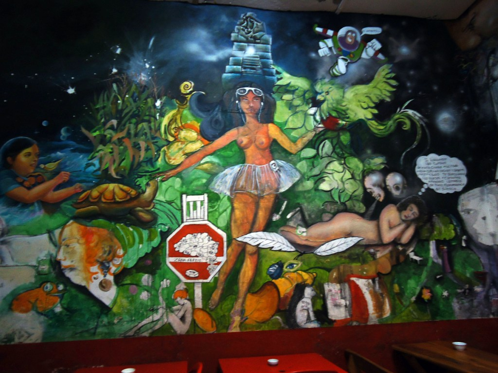 Part of a painted mural in a dark Guatemalan bar