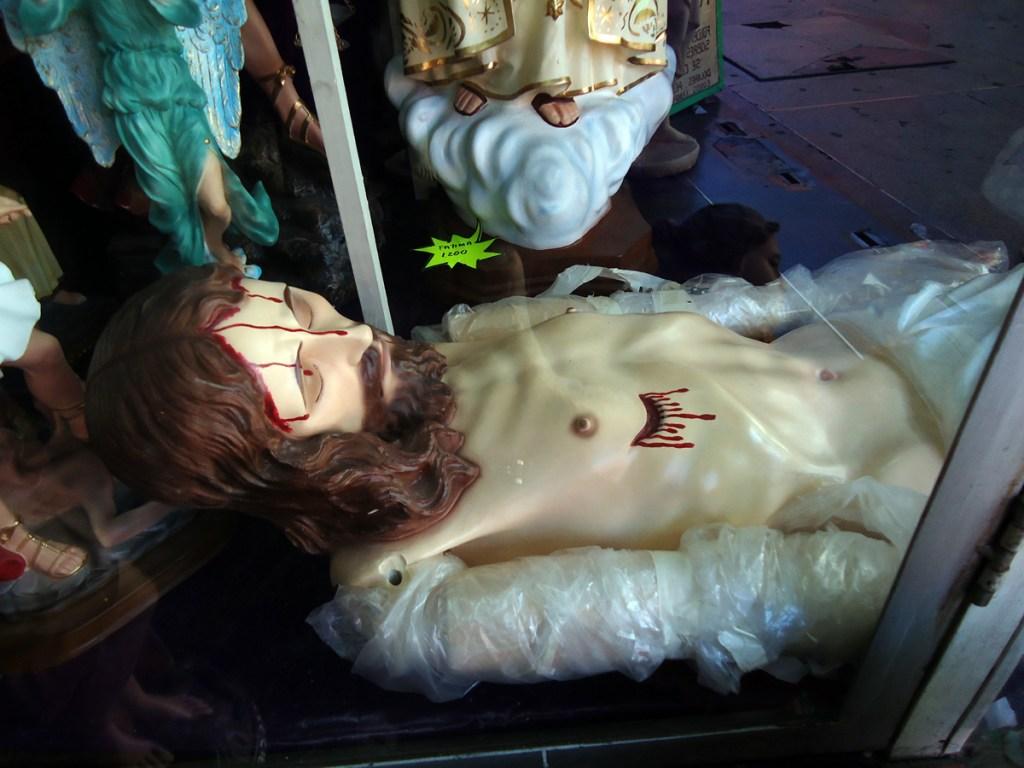 Crazy window display. Jesus mannequin for sale.