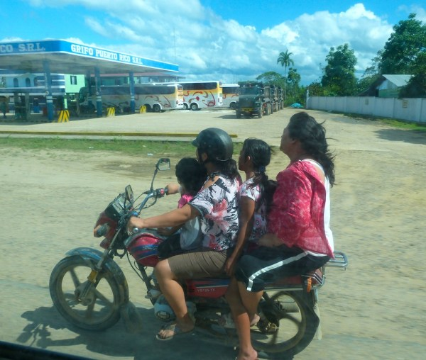 What the? 4 Girls on a motorcycle. I guess it's Ok. They all fit, after all.