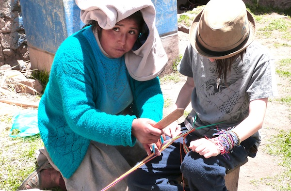 Miro learning how to weave in Peru