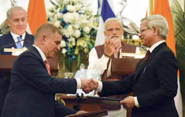 PM Modi and Mr Netanyahu witnessing the signing of an agreement