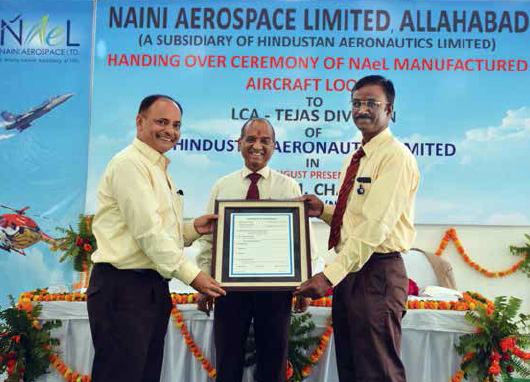 Mr. R. K. Mishra, CEO, NAeL (left) presenting the Certificate of Conformity of aircraft and helicopter looms to Mr. M S Velpari, GM, LCA Tejas Division-HAL (right) in the presence of Mr. V M Chamola, Chairman (NAeL) and Director (HR)-HAL at a function held at Naini, Allahabad