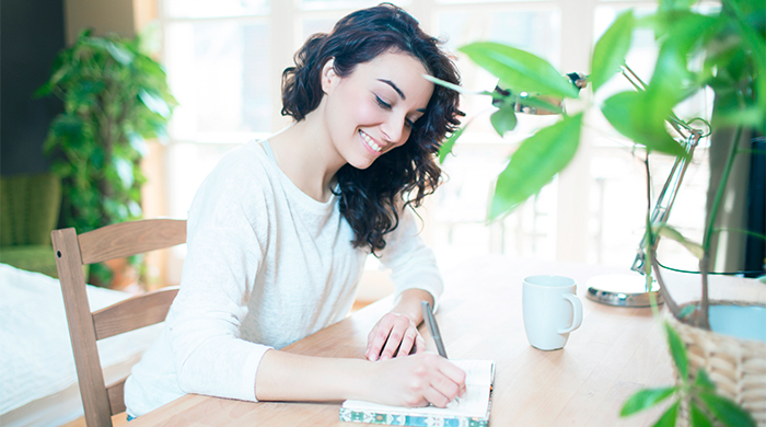 Young Woman Writes in Planner