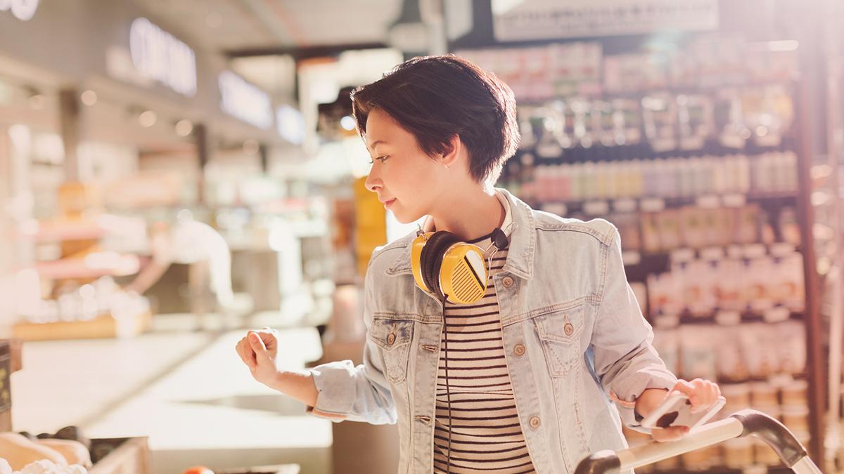 Girl with headphones around her neck