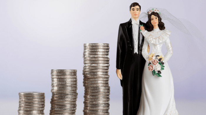 Stack of change next two bride and groom figurines