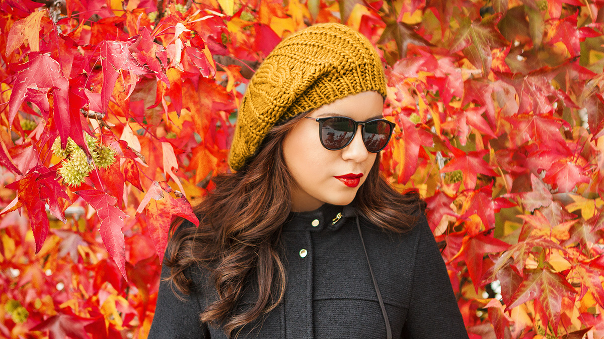 girl wearing a beanie and sunglasses