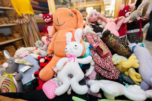 Heap of stuffed toys in gift store