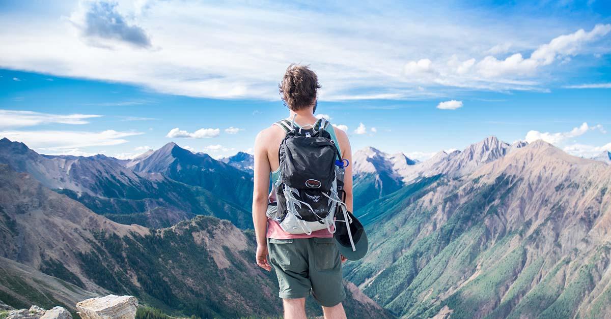 Man overlooking mountains