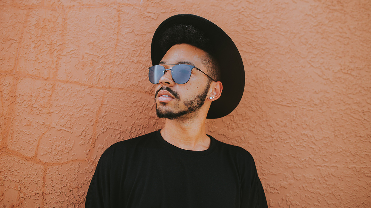 Man wearing a hat and sunglasses