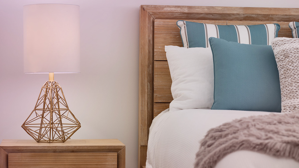 Bed and nightstand with lamp