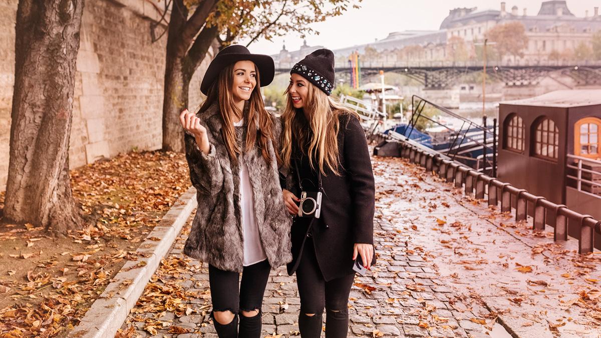 Two fashion girls walking together
