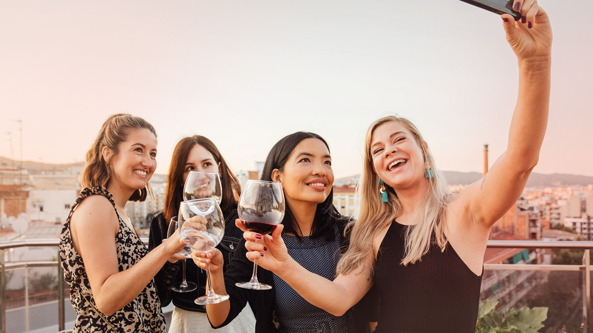 Girls toasting each other