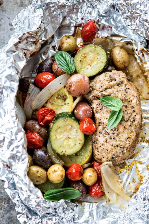 Good Life Eats PESTO PORK CHOP AND SUMMER VEGETABLE FOIL DINNERS