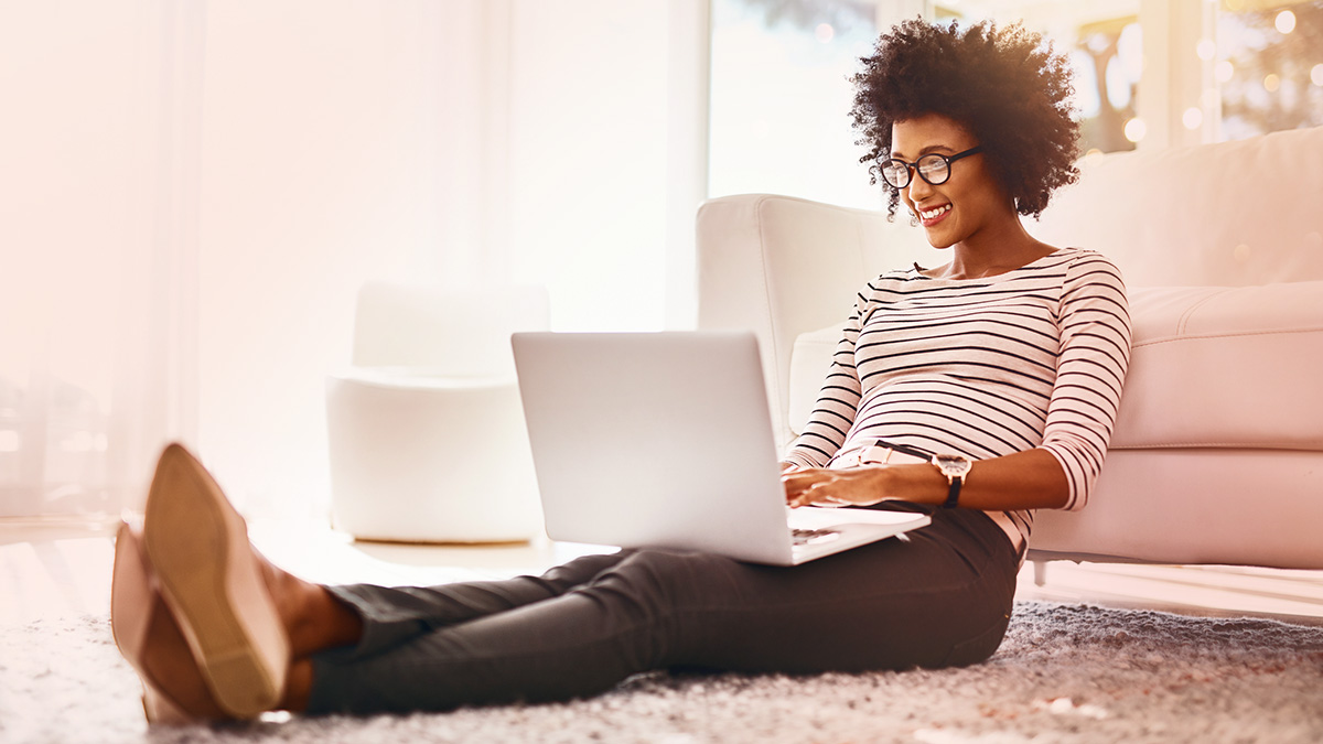 Girl sitting on floor with laptop