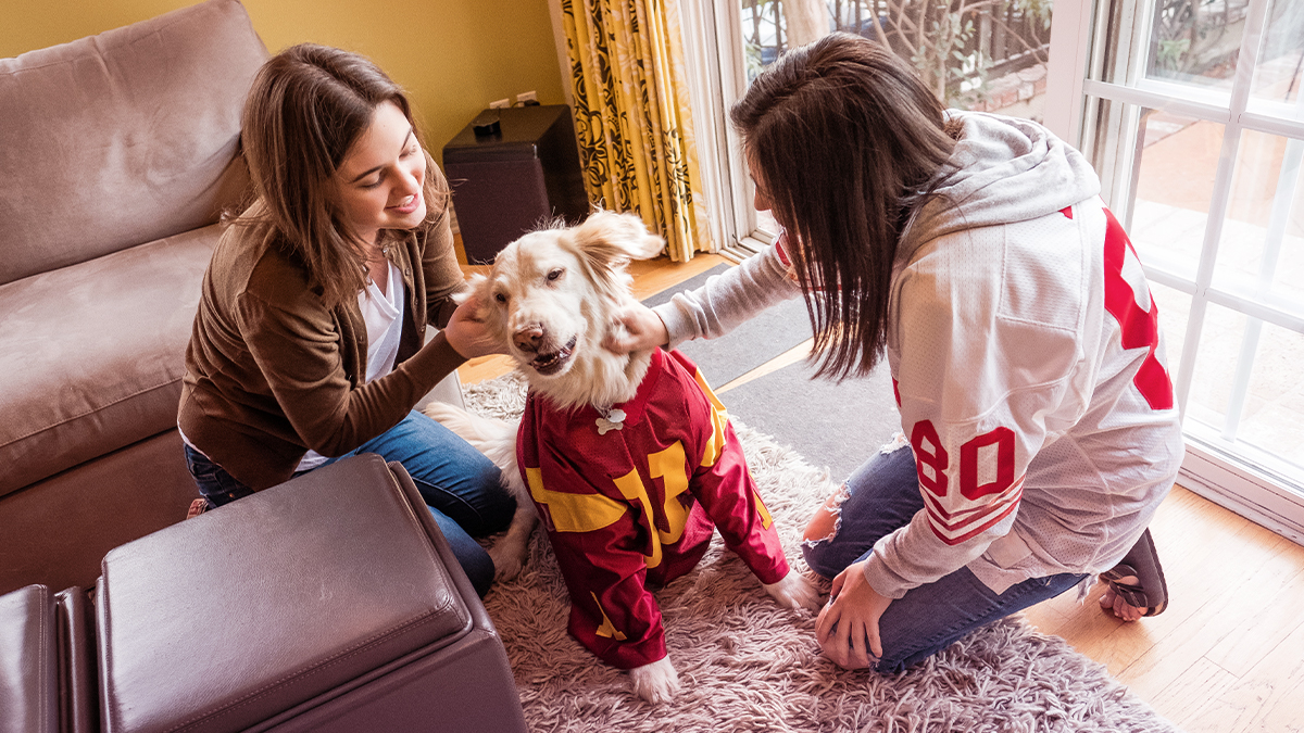 Girls with dog and jerseys