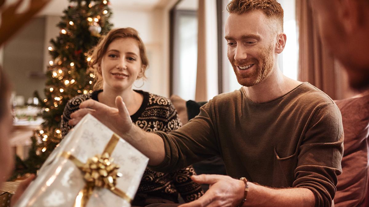Guy receiving gift
