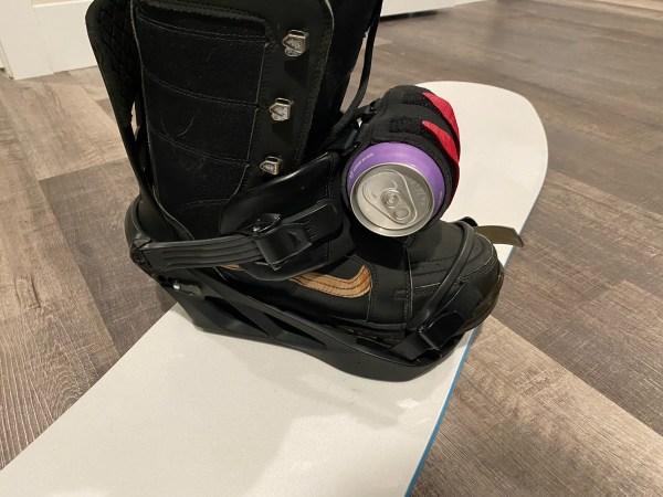 Snowboard binding strap beer mount