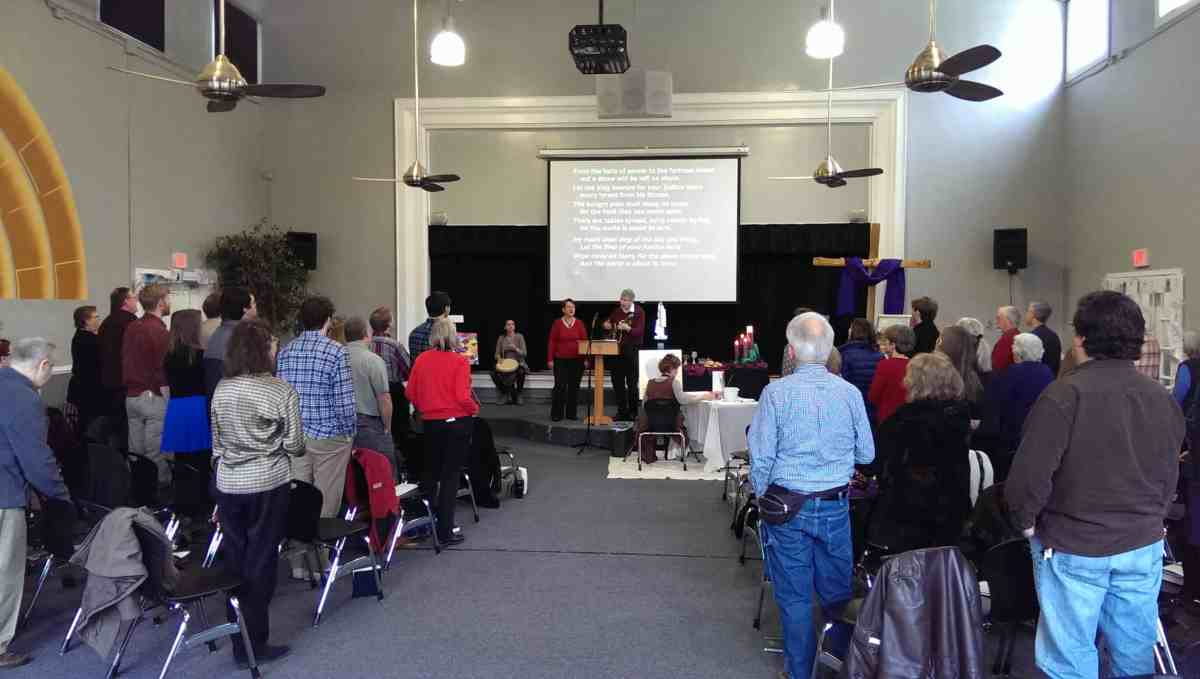 Singing as a congregation with Luz painting, Sunday, Dec. 21, 2014.
