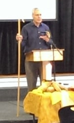Duane preaching with his shepherd's crook.