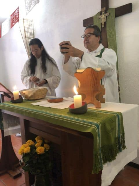 Communion service with priest blessing the cup in Oaxaca, Mexico