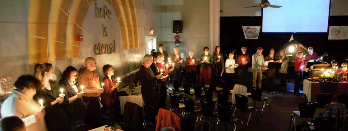 RMC Christmas Eve service singing in candlelight. Dec. 24, 2019