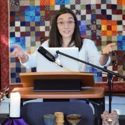 Melissa preaching, holding up hands, Jan. 26, 2020
