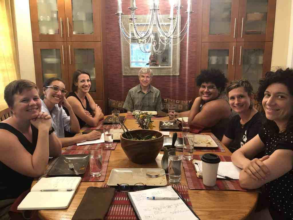 Delegation around dinner table planning El Salvador itinerary