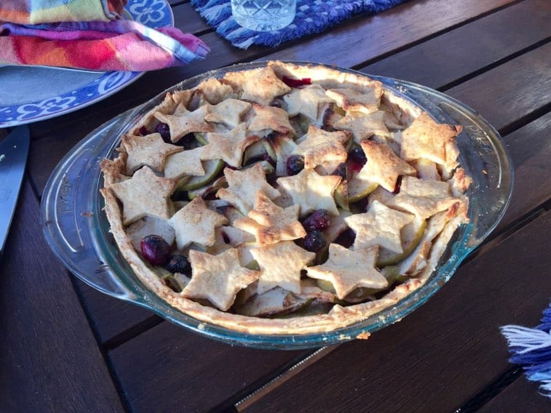 An apple cranberry pie with a star-shaped crust.