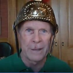 Hans in a gladiator helmet giving the homily on April 11, 2021