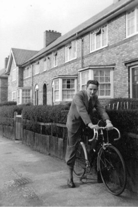 Outside his home in 47 Redington Road, Allerton, Liverpool. 1951. He appears to be on his pre war Raleigh Record Ace. He is riding this cycle either fixed wheel or single speed. Using only one front brake it appears to be set up for club work (although this was default standard for the pre war RRA). He is dressed, however in his best bib and tucker! Looking at Google maps you can see EXACTLY where this photograph was taken. His foot is on a utility cover which is there to this day.