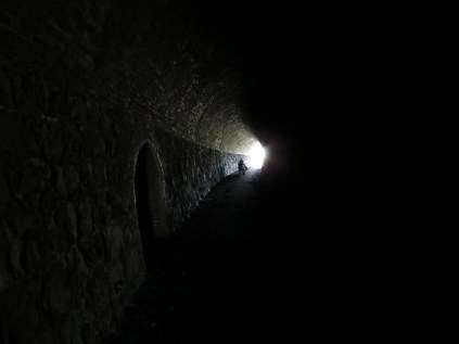 In a hand-hewn tunnel.