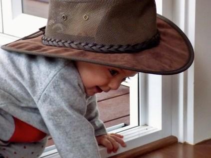Julia tries on Australian hat.