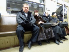 Muscovites on the Metro in bright colours.