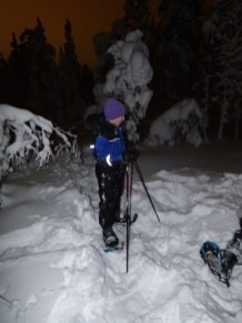 On snowshoes.