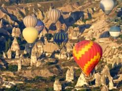 Balloons and Cappadocia rock formations.