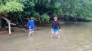The crab hunters sinking in mud.