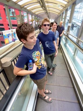 On the escalator.