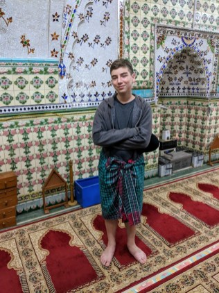 Dec at the mosque with borrowed lungi.