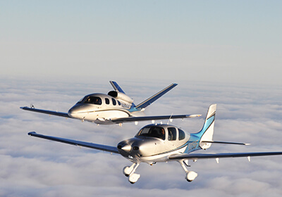 2 airplanes above the clouds