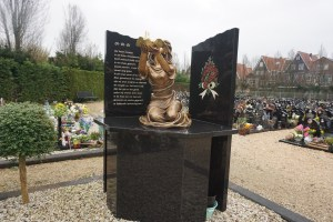 Monument facing the fourteen graves of the 2001 fire's victims by Elena Finariu (The Scars of the 2001 Tragedy Volendam)