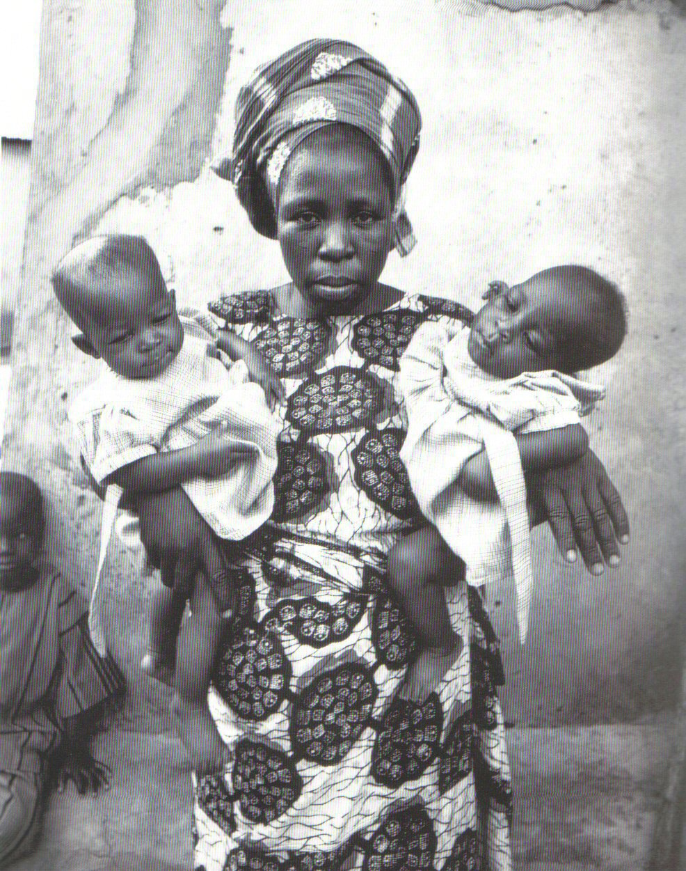 https://i2.wp.com/www.randafricanart.com/images/Yoruba_woman_holding_twins.jpg