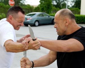 Image of Mike Lee Kanarek demonstrating a knife disarming technique