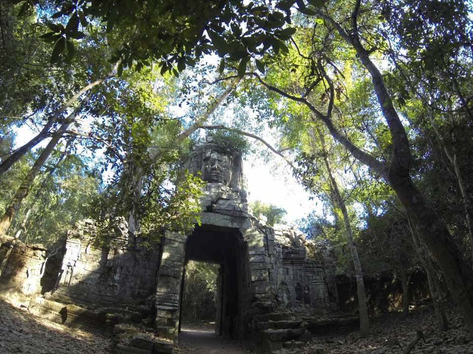 Passing through an ancient gate with faces near Angkor Wat
