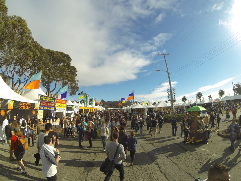 Festival goers walking by food stands at Treasure Island Music Festival 2015