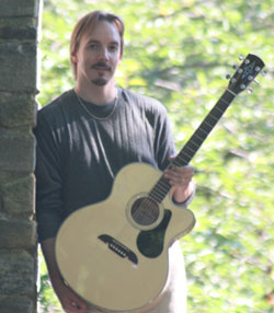 Randy Ellefson with guitar, 2010