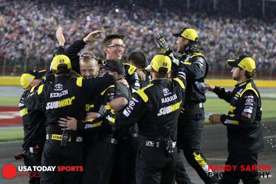 May 24, 2015; Concord, NC, USA; NASCAR Sprint Cup Series driver Carl Edwards (19) crew celebrates winning the Coca-Cola 600 at Charlotte Motor Speedway. Mandatory Credit: Randy Sartin-USA TODAY Sports