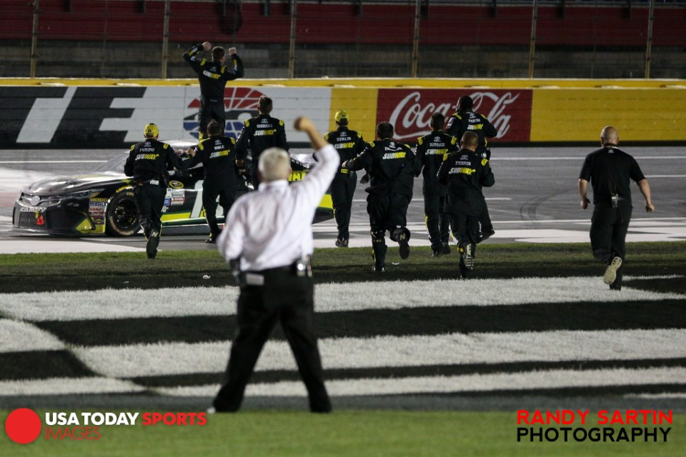 May 24, 2015; Concord, NC, USA; NASCAR Sprint Cup Series driver Carl Edwards (19) and his crew celebrates winning the Coca-Cola 600 at Charlotte Motor Speedway. Mandatory Credit: Randy Sartin-USA TODAY Sports
