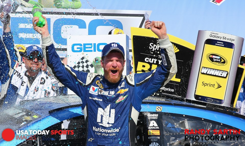 May 3, 2015; Talladega, AL, USA; NASCAR Sprint Cup Series driver Dale Earnhardt Jr. (88) celebrates from victory lane after winning the Geico 500 at Talladega Superspeedway. Mandatory Credit: Randy Sartin-USA TODAY Sports